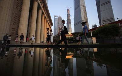 File photo of people walking to a subway station at the financial district of Pudong in Shanghai