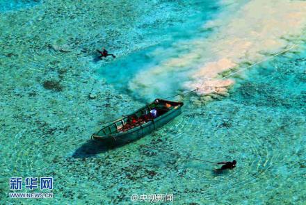 央视发布西沙群岛官方图片中疑现渔民采捕濒危贝类