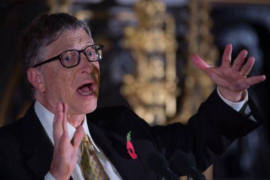 """英国伦敦当地时间2014年11月10日,,微软创始人之一比尔·盖茨就""""国际援助""""发表演讲后回答记者提问。 CFP 图"""