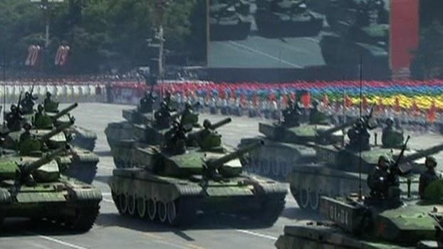资料图片:据报道,中共建政以来,共举行过14次公开性的阅兵。(法新社视频截图)