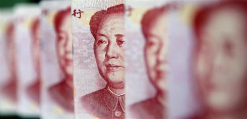 Yuan banknotes are seen in this illustrative photograph taken in Beijing July 26, 2010. There is no basis for a major appreciation in the yuan exchange rate, the State Information Center, a government think tank, said on Monday. REUTERS/Jason Lee (CHINA - Tags: BUSINESS IMAGES OF THE DAY)