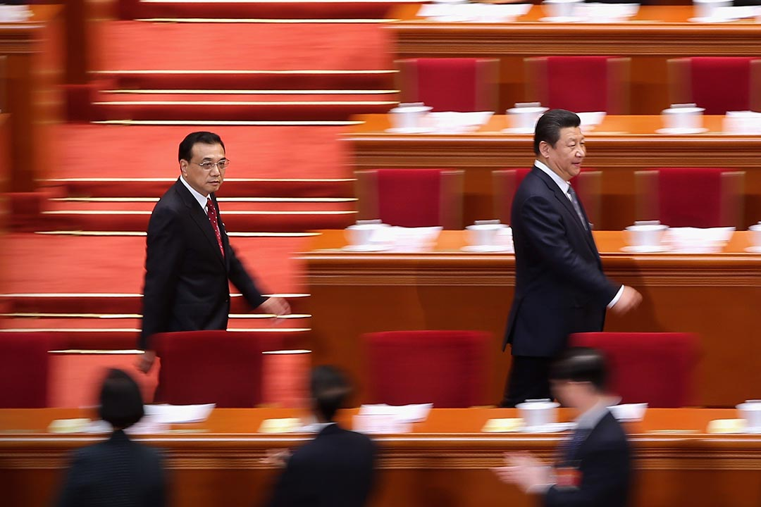 BEIJING, CHINA - MARCH 08: China's President Xi Jinping (R) and Premier Li Keqiang (L) arrive for the second plenary session of China's parliament, the National People's Congress (NPC), at the Great Hall of the People on March 8, 2015 in Beijing, China. China plans to develop national legislation to fight corruption, according to the work report delivered by Chairman of the Standing Committee of the NPC Zhang Dejiang Sunday. (Photo by Feng Li/Getty Images)