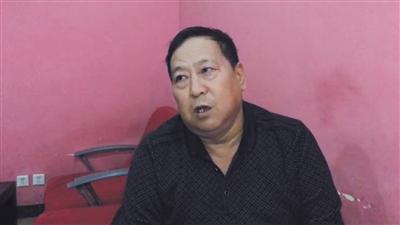 12月2日下午6点,郑成月在北京西站接受记者专访。新京报记者 李相蓉 摄