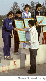 Susan Brownell, far left, accepting the sixth-place award for Beijing University in the 1986 Beijing City College Meet. (WSJ, Susan Brownell Family)