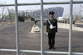 A security guard keeps watch over the Bird\'s Nest in Beijing