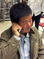 Chinese engineer Long Xiaowei makes a call home at the Chinese embassy in Islamabad after six months in captivity. (Photo: AP/Xinhua, Li Jingchen)