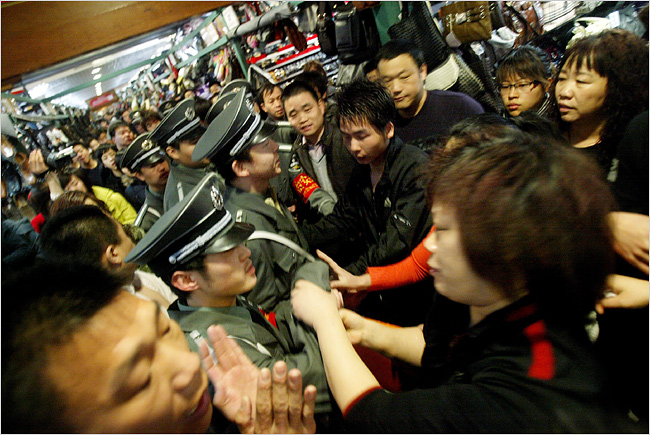 A February clash between vendors and guards closing a luxury goods shop in Silk Street Market (Photo: Agence France-Presse - Getty Images).