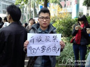 "Protester in Guangzhou. ""End press censorship. The Chinese want freedom!"""