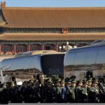Early on the morning of March 4, the delegation of representatives from the People's Liberation Army crosses Tiananmen Square to take part in the first preparatory meeting of the 12th NPC. (ChinaNews)