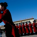 March 4: Female servers for the Two Sessions take a group photo in Tiananmen Square. (ChinaNews)
