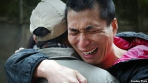 Wu Changlong embraces his father. He was found innocent and released from prison after serving 12 years. (Wu Huaying)