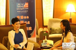 Li Xiaolin (left) in an interview with Ta Kung Pao. (Ta Kung Pao)
