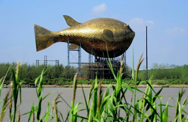 China Vows Austerity; Giant Fish Devours $11 Million