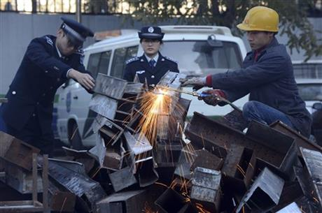 Beijing Destroys Barbecue Grills to Cut Pollution