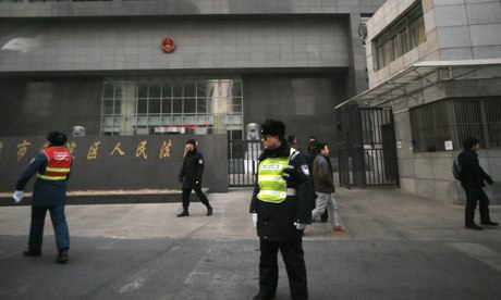 China Puts Two More Activists on Trial