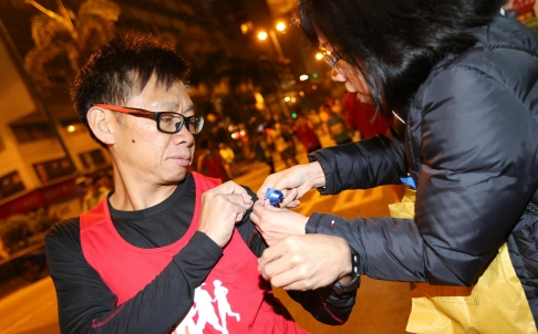 Runners Sport Ribbons in Support of Press Freedom