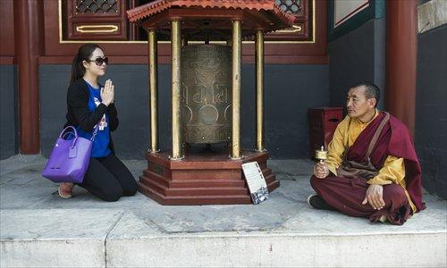 Dissatisfied Chinese Turn to Mao, Jesus, Tibet, Australia