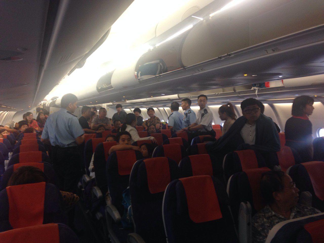 "Minitrue: Mainland Tourists ""Detained"" on HK Runway"
