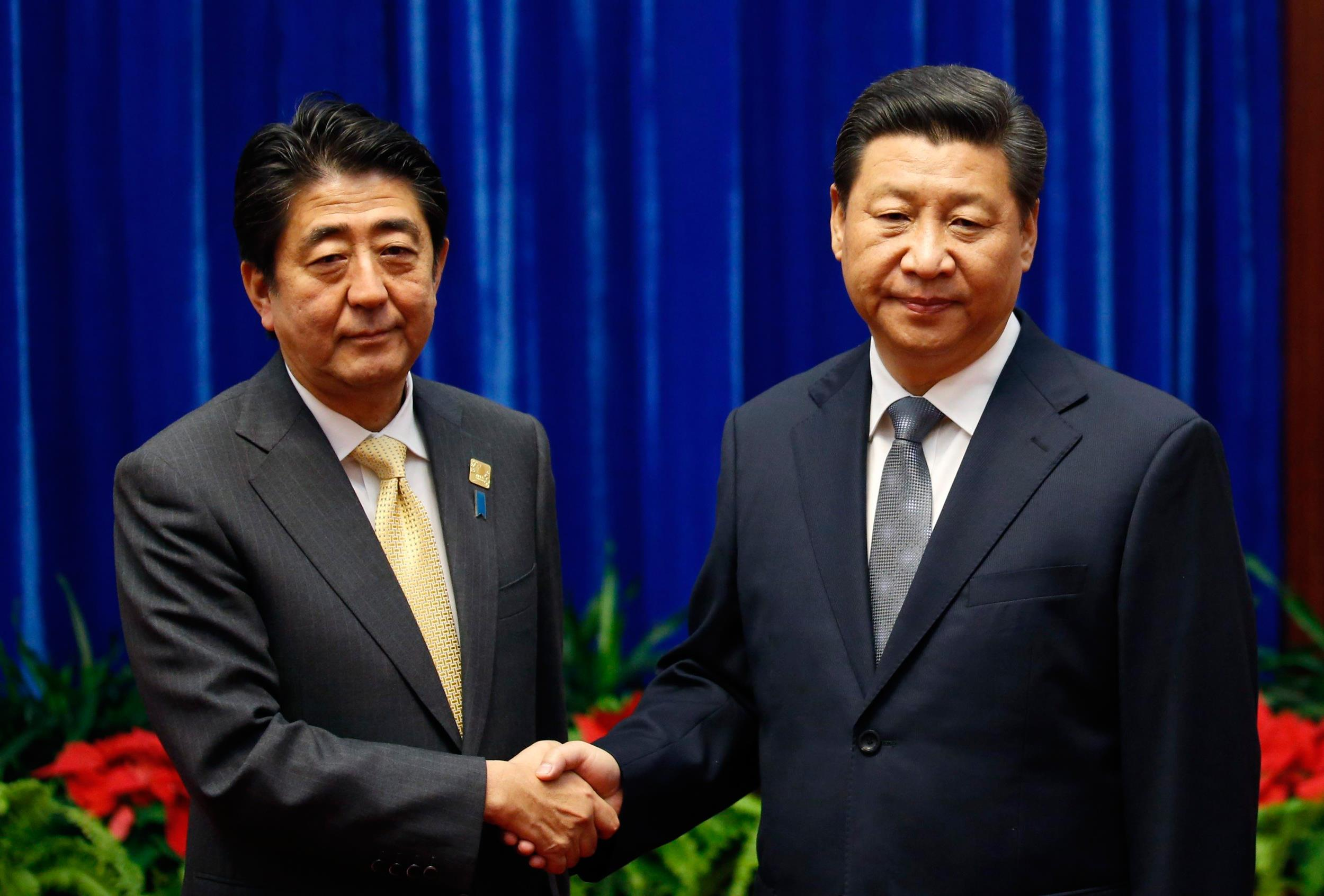 Frosty Meeting Between Xi and Abe Aims To Break Ice