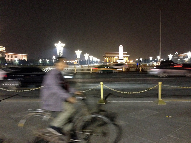 Cyclist at night on Tiananmen Square