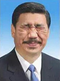"Dai Jianyong's photo of Xi Jinping wearing ""chrysanthemum face"" (via RFA)"