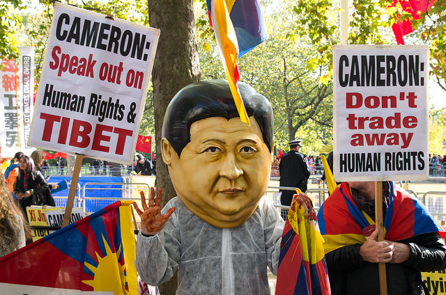 Tibetan protesters greet the Chinese President