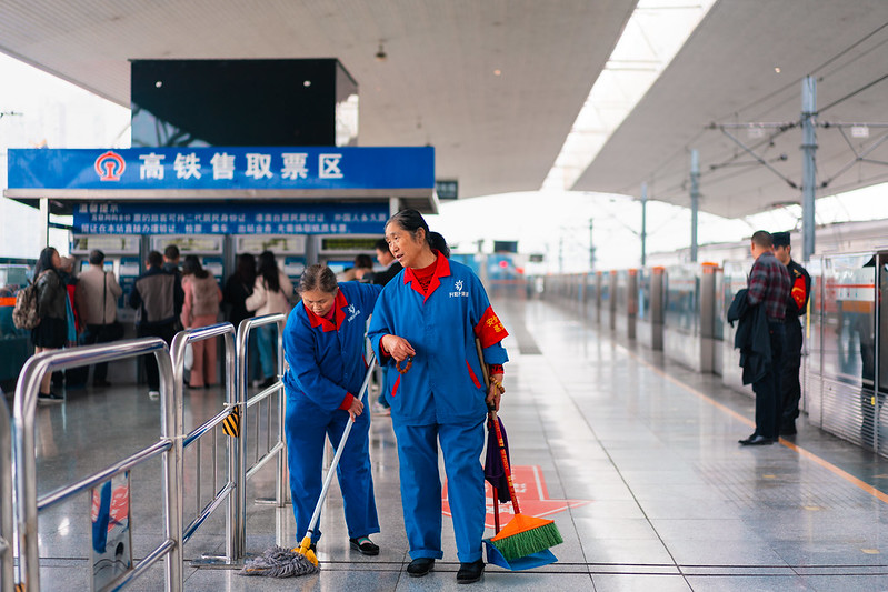 Photo: Cleaning Staff at Train Station in Chengdu, by Kristoffer Trolle