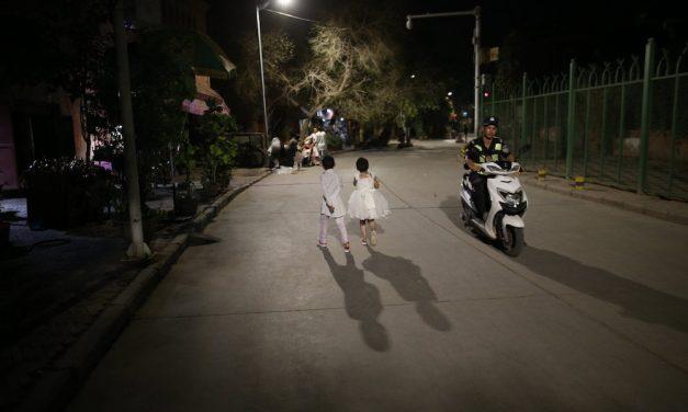 Photo: Local children and police patrol, Kashgar Old City, by Polina Fedorova