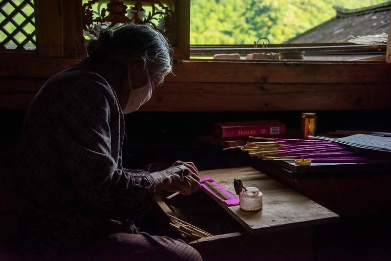 Photo: Making Joss Sticks, by Rod Waddington