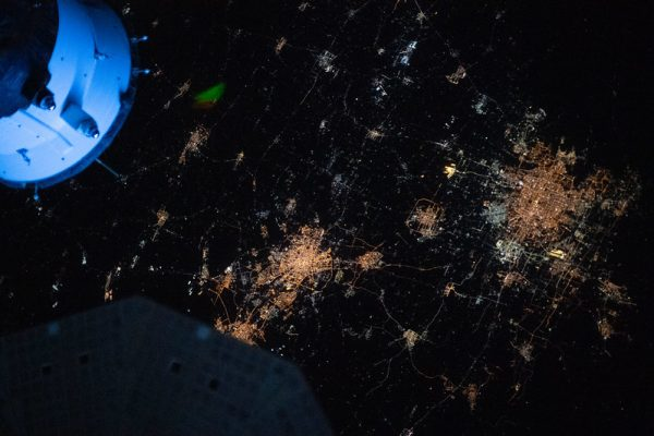 The night lights of Beijing and Tianjin in China are pictured from the International Space Station as it orbited 264 miles above the Asian continent near the Yellow Sea.